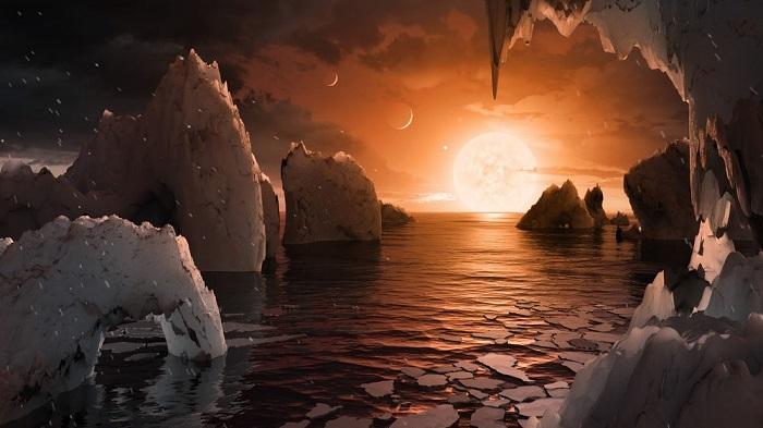 کانسپتی دیدنی از حیات در منظومه تراپیست-۱. منظومه تراپیست-۱ در صورت فلکی دلو قرار دارد و حدود ۳۷۸ تریلیون کیلومتر از زمین ما فاصله دارد