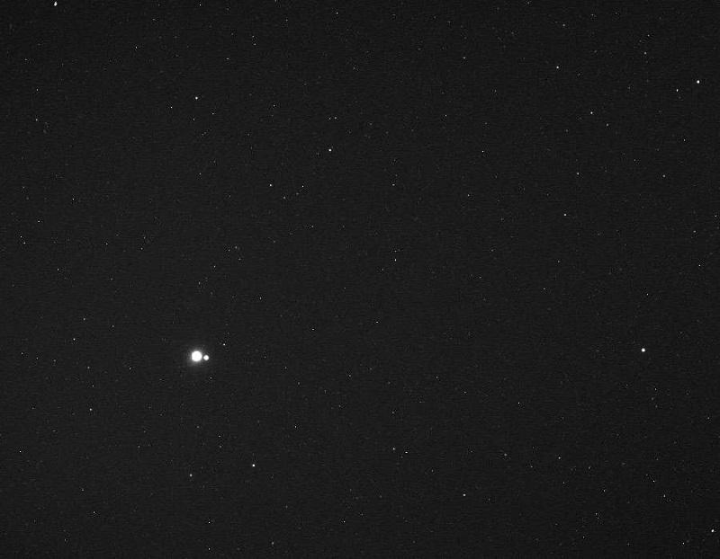 تصویر مینجر از زمین و ماه